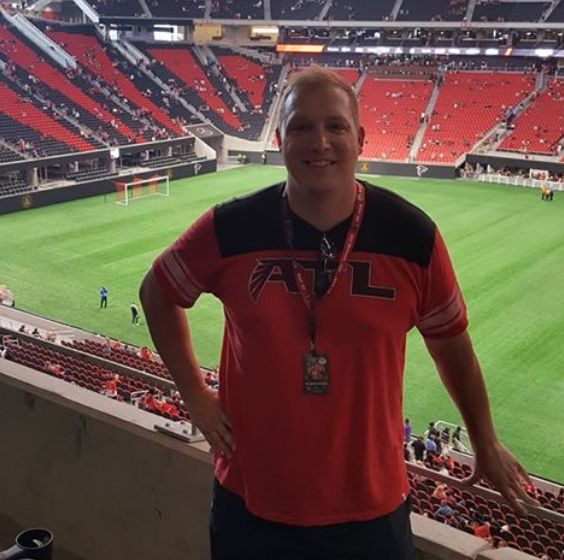 Ryan Blythe standing in Atlanta stadium.
